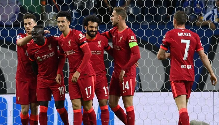 Salah, Firmino shine as Liverpool honour Hunt with Porto rout