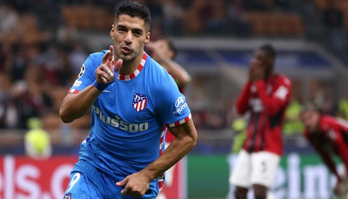 Suarez completes late comeback as Atletico win at 10-man Milan