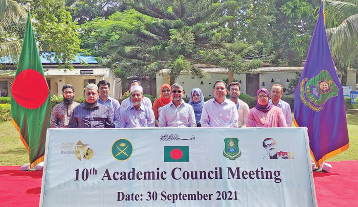 Bangladesh Army International University of Science and Technology (BAIUST) Vice Chancellor Professor KM Salzar Hossain (Retd Brigadier General) along with guests poses for a photograph after attending the 10th Academic Council Meeting on the university campus on Thursday.— Sun Photo