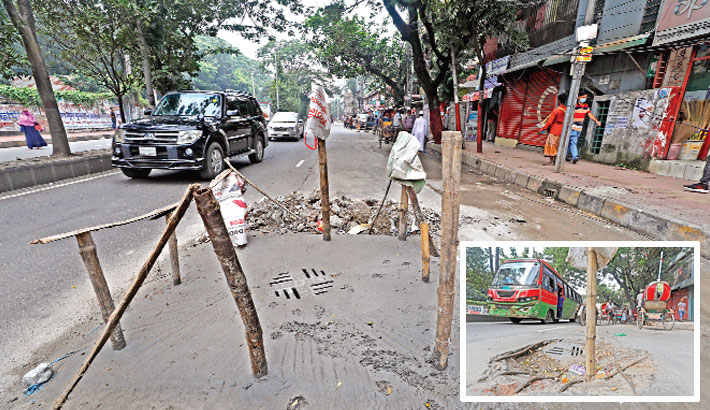 The DSCC authorities replace the lid of a broken manhole on Atish Dipankar Road in the capital's Sabujbagh area after a photograph of this death trap with a bamboo pole sticking out from the damaged manhole (inset) was  published on the Daily Sun on last Tuesday. The snap was taken on Friday. —Kamrul Islam Ratan