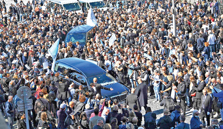 Supporters surround the funeral van carrying the coffin of Bernard Tapie, the French business magnate, actor and politician, following the funeral mass at the Major cathedral in Marseille, southeastern France, on Friday. — AFP Photo