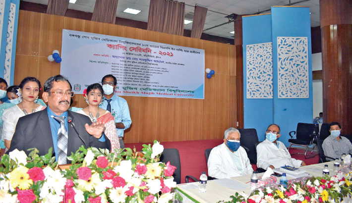 Bangabandhu Sheikh Mujib Medical University Vice-Chancellor Professor Dr Md Sharfuddin Ahmed speaks at the capping ceremony for BSc nursing students of the 10th batch of BSMMU on the university premises in the city on Saturday. —SUN PHOTO