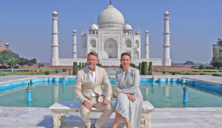 Denmark's Prime Minister Mette Frederiksen and her husband Bo Tengberg pose for picture during their visit at the Taj Mahal in Agra on Sunday. — AFP PHOTO