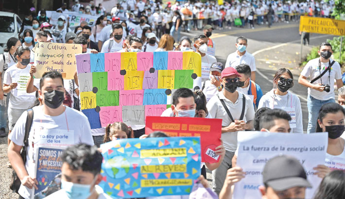 Youngsters take part in a march under the slogan of
