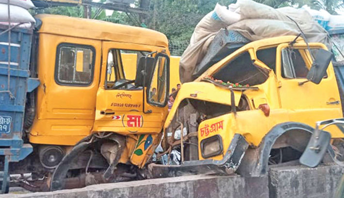 The mangled remains of two goods-leaden trucks after the vehicles collide head-on on Dhaka-Chattogram highway in Dewanhat area in Chattogram on Monday. SUN photo