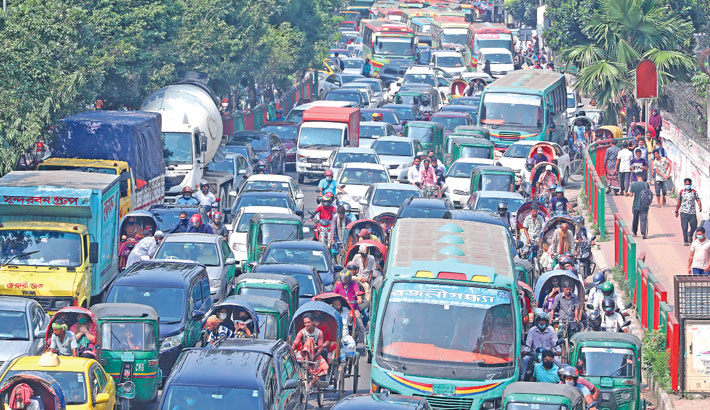 Hundreds of vehicles get stuck in a long tailback on Mirpur road in the capital on Monday. The photo was taken from f Science Laboratory intersection. sun photo