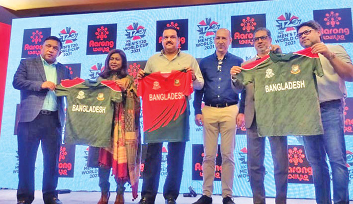 Bangladesh Cricket Board Directors and Sports and Sportz senior officials hold jerseys of Bangladesh national cricket team for the upcoming ICC Men's T20 World Cup during an unveiling ceremony at a city hotel in Dhaka on Monday. – TANVIN TAMIM