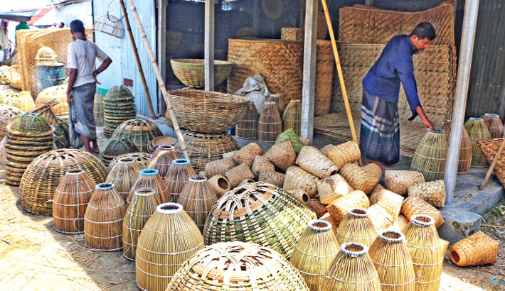 Different bamboo and cane-made products, which are used for domestic purposes by villagers, have been put on display for sale at Natuapara Bazar in Kazipur Upazila of Sirajganj district. The photo was taken on Monday.– Star Mail