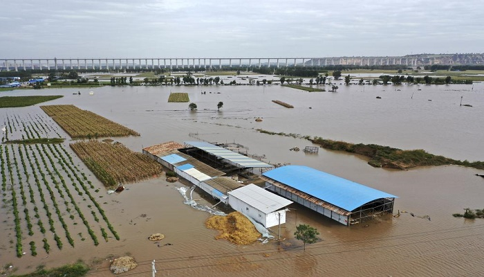 Bus plunge, floods leave at least 28 dead in northern China