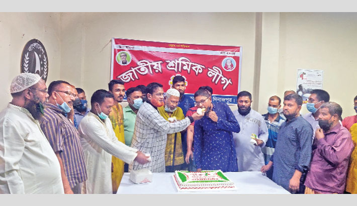 Leaders and activists of Hakimpur Upazila unit of Bangladesh Jatiya Sramik League (BJSL), the labour wing of Bangladesh Awami League, cut a cake at the unit office in Banglahili Bazar of the upazila in Dinajpur district on Tuesday, marking the 52nd founding anniversary of the organisation.– Sun Photo