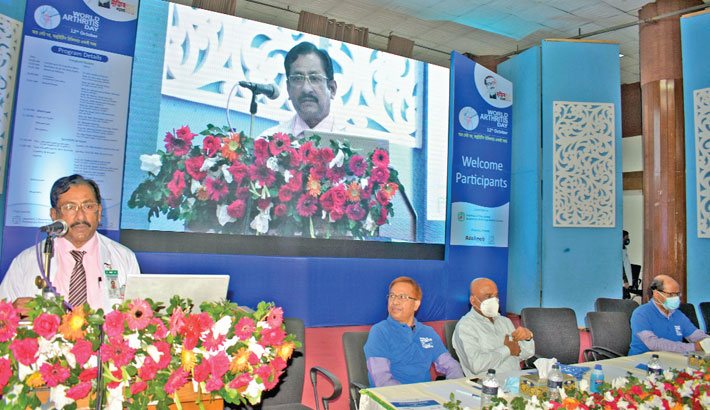 BSMMU Vice-Chancellor Professor Dr Md Sharfuddin Ahmed speaks at a programme jointly organised by Rheumatology and Physical Medicine and Rehabilitation Departments on the university premises in the capital on Tuesday, marking World Arthritis Day.