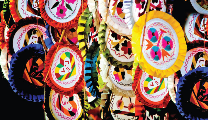 Villagers become self-reliant by making hand fans in Gaibandha