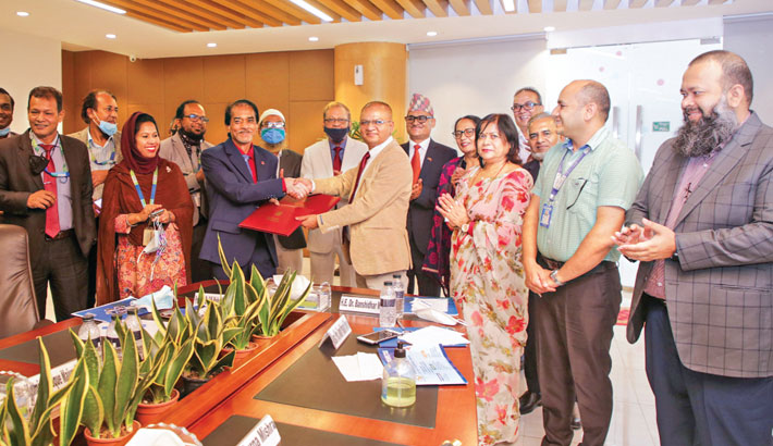 In presence of Nepalese Ambassador to Bangladesh Dr Banshidhar Mishra, Registrar of Daffodil International University (DIU) Professor Dr AKM Fazlul Hoque and Vice-Chairperson of Monmohan Memorial Institute of Health Sciences Jiwan Prakash Sharma exchange agreement documents for academic partnership in Nepal and Bangladesh at a singing ceremony on the university premises on Wednesday.