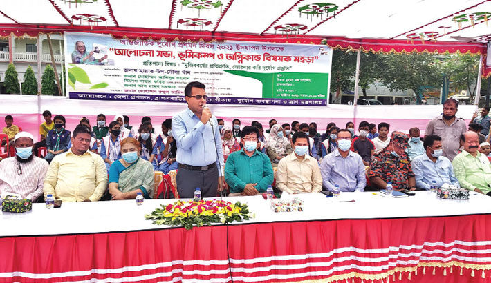 Deputy Commissioner of Brahmanbaria district Hayat-Ud-Dowllah Khan speaks as the chief guest at a discussion on International Day for Disaster Risk Reduction held at Niaz Mohammad High School ground in the district town on Wednesday.— Sun Photo
