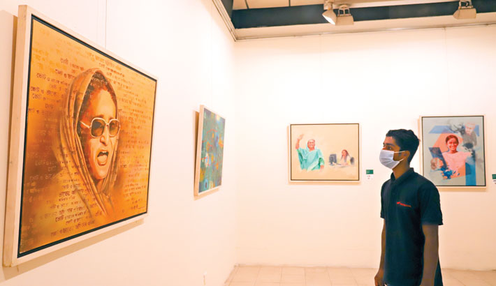 A visitor admires artworks on Prime Minister Sheikh Hasina at National Art Gallery of Bangladesh Shilpakala Academy (BSA) on Thursday. BSA organised a month-long exhibition featuring artworks of 75 women artists, marking the 75th birthday of Prime Minister.   -   Md Nasir Uddin