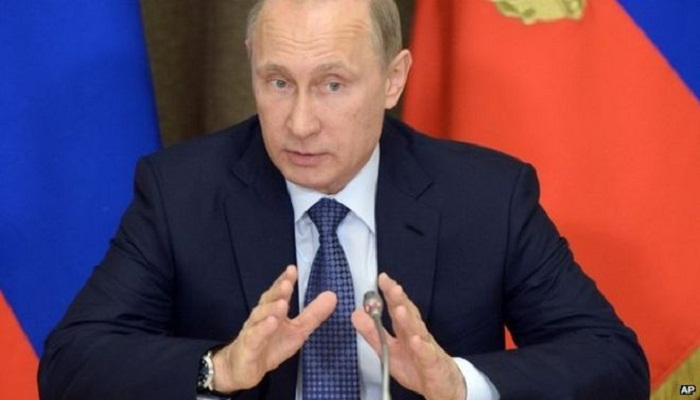 Russia's Putin signs law against 'undesirable' NGOs