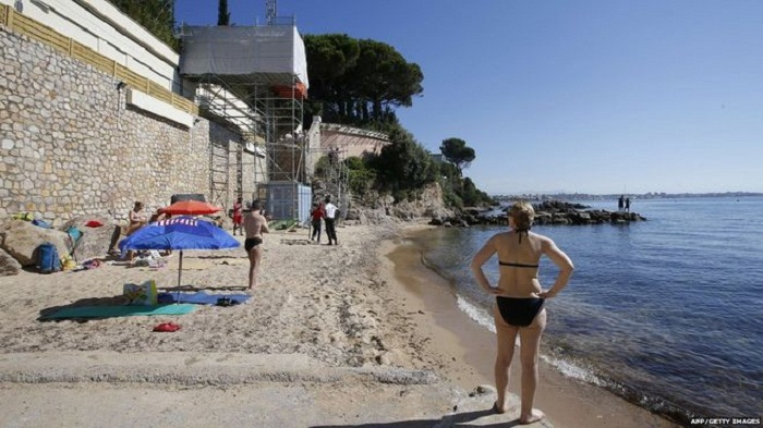 French beach closed for Saudi king's holiday reopens