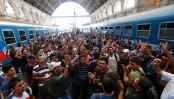 Migrants flood Budapest rail station; no trains to the West