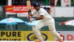 Pujara century pips Dhammika's efforts on Day 2