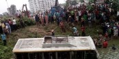 Bus hits roadside ditch from flyover in city, 5 injured