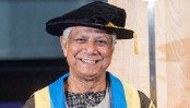 Dr Yunus hands over honorary degree to Dr Kerry Kennedy
