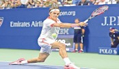 Federer cruises, Murray struggles